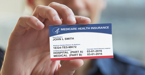 man holding a new Medicare card
